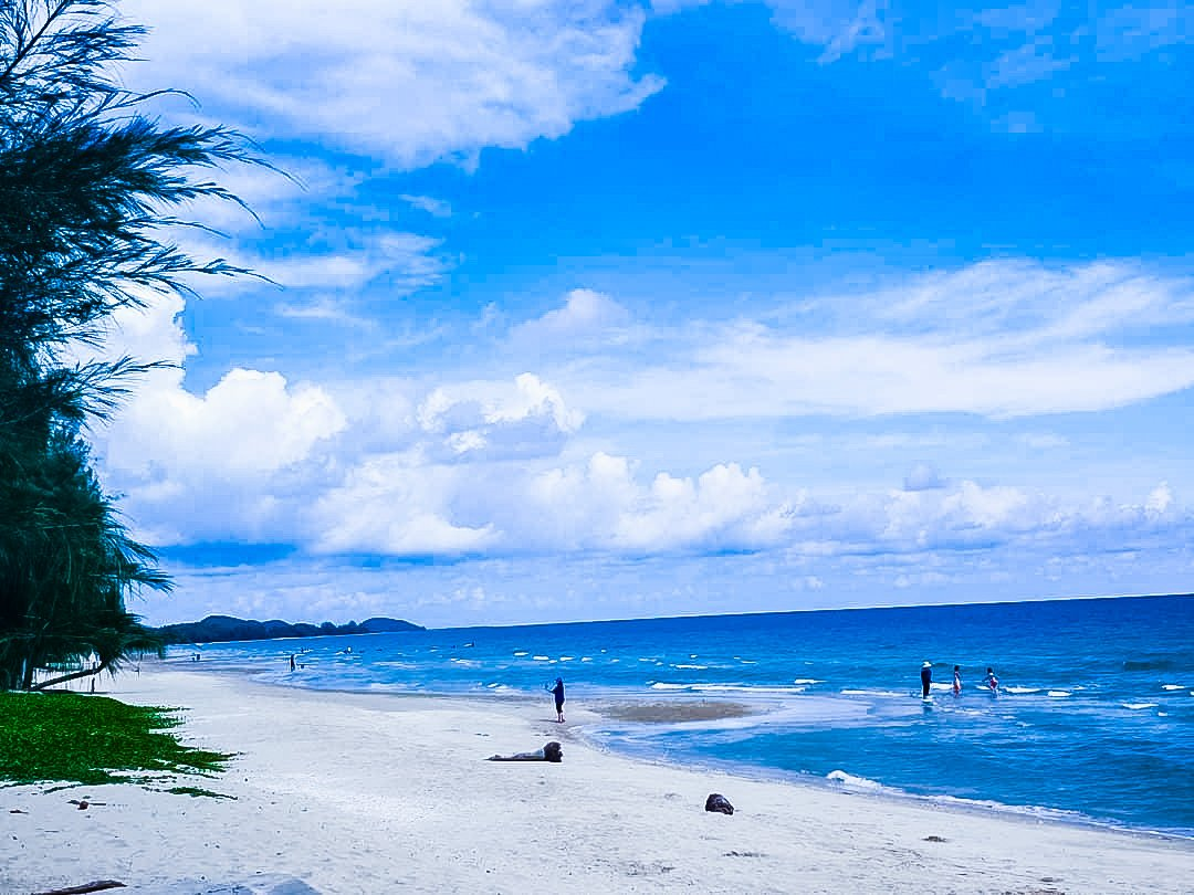 Dreamiest Laem Sadet Beach with blue sky and people enjoying on beach.
